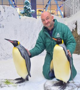 Adriaan Bloem with two Emperor Penguins